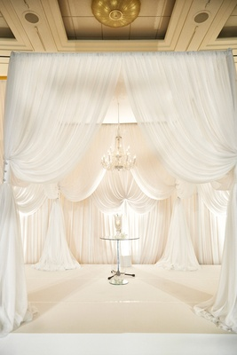 white curtain ceremony arch, all white altar drapery