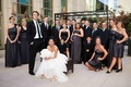 Grey-black bridesmaid dresses and groomsmen in tuxedos