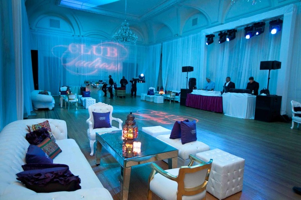 Wedding after-party with a club theme and light blue lighting