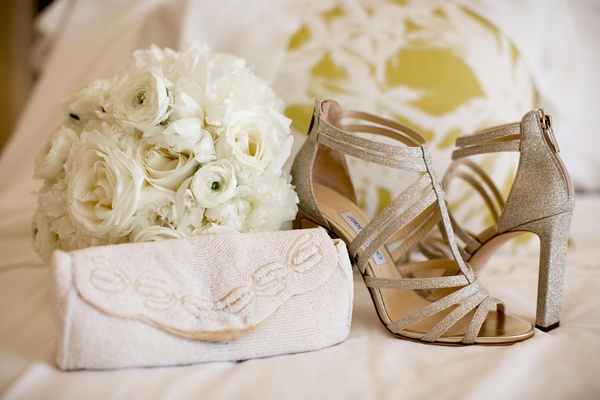 glittery strappy jimmy choo bridal heels with white beaded bridal clutch purse