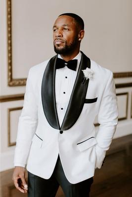 r&b singer tank wedding, white tuxedo jacket with black lapels and pants