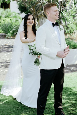 destination wedding in hawaii bride in crepe gown groom in white tuxedo jacket bow tie outdoor look
