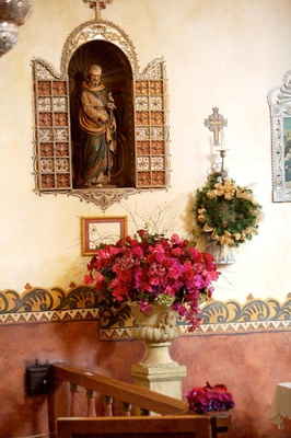Jewel tone floral arrangement in Spanish style mission church