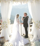 wedding ceremony structure circle white rose hydrangea orchid flowers santa monica mountain view