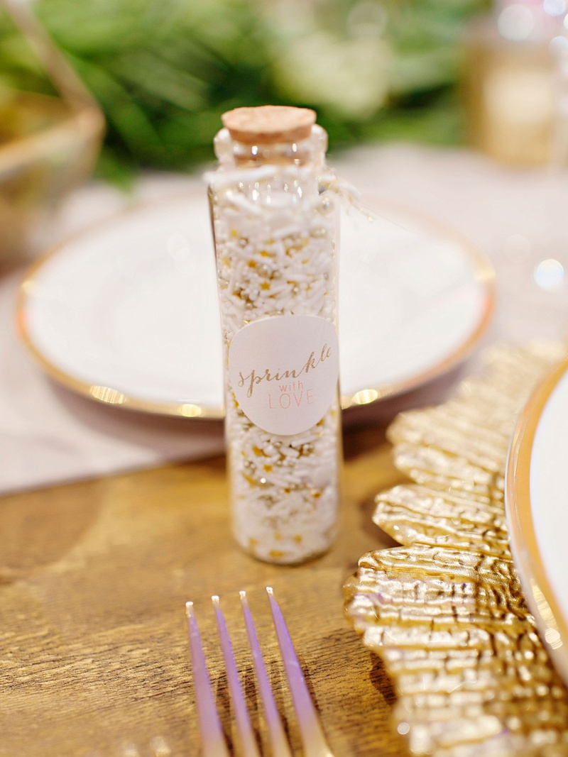 Wedding reception favors sprinkles in glass bottle with cork to throw at couple during grand exit