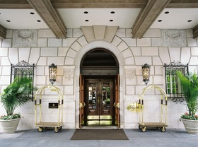 Wedding reception location The Hay-Adams in Washington, DC bellhop carts plants sconces