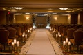 indoor ceremony space gold concept hotel ballroom jewish wedding chuppah white runner candles petals