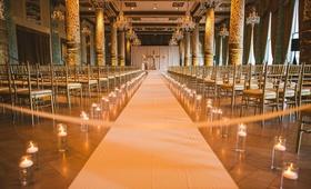 wedding ceremony at the drake hotel chicago white aisle runner hurricane vase candles candlelight