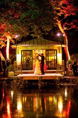 Bride in a cap sleeve gown dances with groom in a dark suit