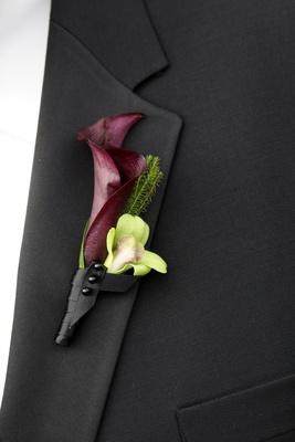 Groomsmen wearing black-wrapped flowers on lapel