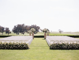 wedding ceremony grass lawn golf course wedding hotel venue white chairs greenery flowers simple