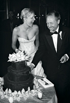 Black and white picture of chocolate wedding cake with orchids