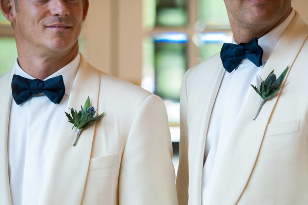 rustic boutonnieres made up of thistles and frond white tuxedo jacket bow tie