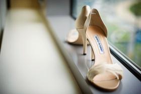 Bride's Manolo Blahnik heels with feathers