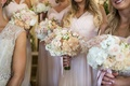 Blush peach and white flowers bridesmaids bouquets