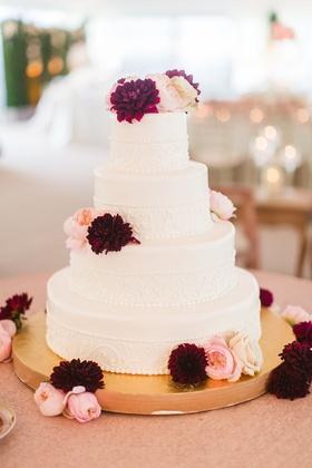 Wedding cake four layer white design fresh flowers dahlia garden rose pink burgundy gold stand