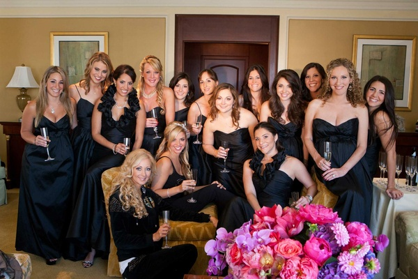Bride getting ready with bridesmaids in black dresses