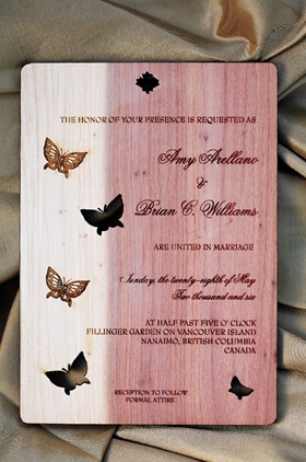 Wedding invitation made of cedar wood and decorated with butterflies