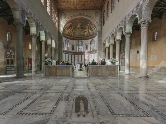 interior of italian church, with marble painted floors and walls and archways