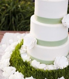White cake decorated with sugar flowers and grass