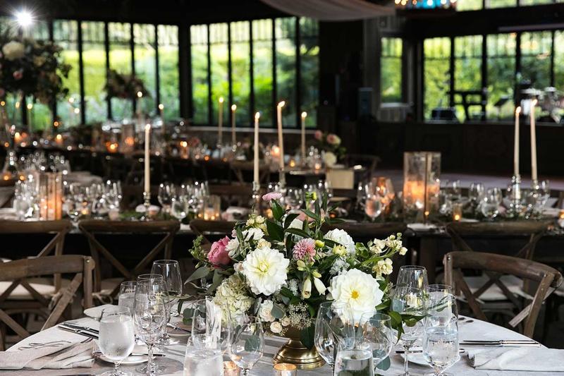 wedding receotion low centerpiece dahlia rose hydrangea gold footed vase wood vineyard chair