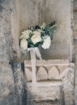 destination wedding in italy bouquet with white roses and dahlia blue purple thistle and greenery