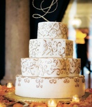 Four layer wedding cake with rhinestone initial cake topper