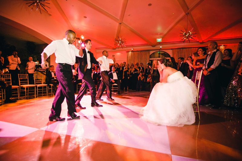 Wedding reception dance surprise Absinthe twin tap dancers with groom on checkerboard dance floor