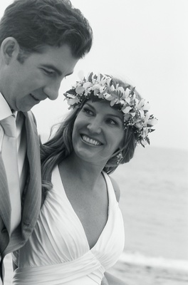 Black and white photo of tropical beach wedding couple