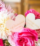 Heart shape escort place cards with gold calligraphy pink rose white dahlia flowers