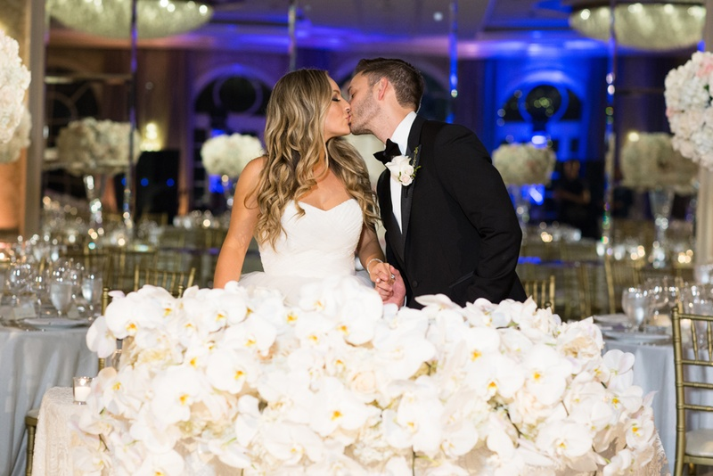 sweetheart table with large display of white orchids