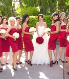 Bride in ball gown and bridesmaids in short dress