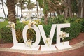 large letters spelling LOVE lead to the entrance of the reception