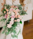 cascading bridal bouquet with garden roses, peonies, dahlias, and greenery