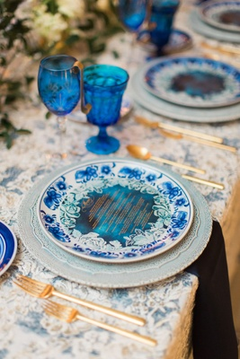 Wedding reception china blue white plate with blue menu card blue glassware goblets