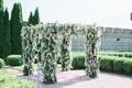 four post ceremony arbor chuppah with greenery, wisteria, hydrangeas