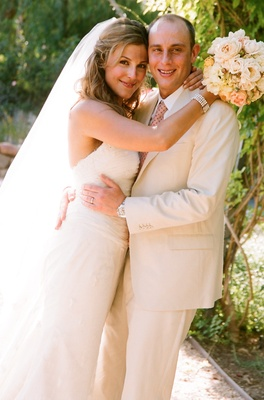Tan groom's suit and white wedding dress