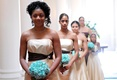 Tan bridesmaid dresses and blue bouquets