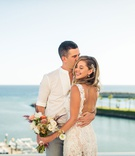 bride with backless lace dress, casual groom, destination wedding in cabo san lucas