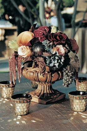 Floral centerpiece and mosaic votive candles