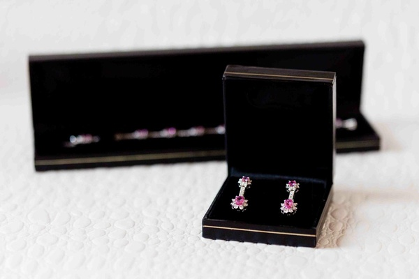 Diamond and pink sapphire bracelet and earrings in black boxes