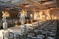 Jewish wedding ceremony at hotel in Chicago with silver chair, white flower, branch details, rustic