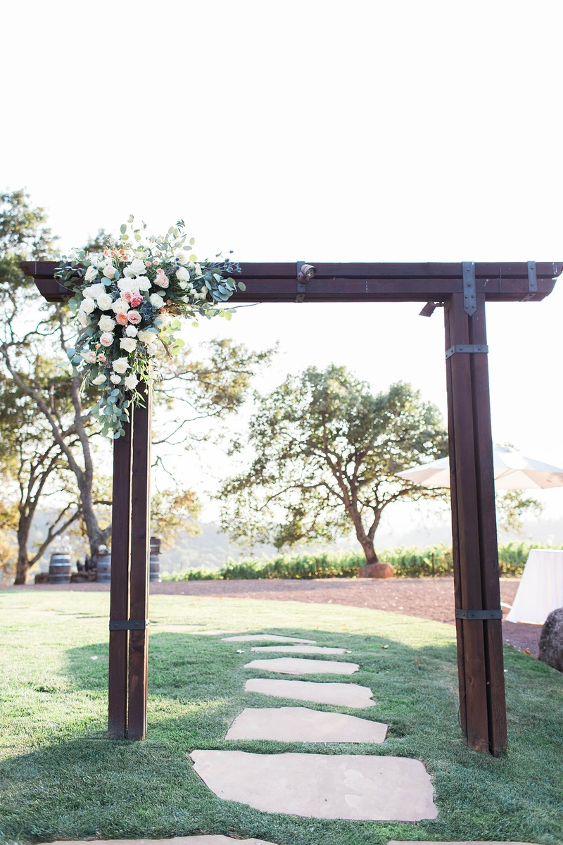 arch outside ceremony floral decor white pink lawn winery rustic northern california wedding