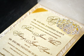 Gold and ivory invite with crystal brooch