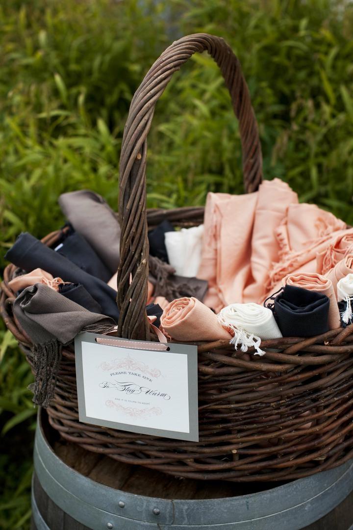 Pashmina scarves in brown wicker basket