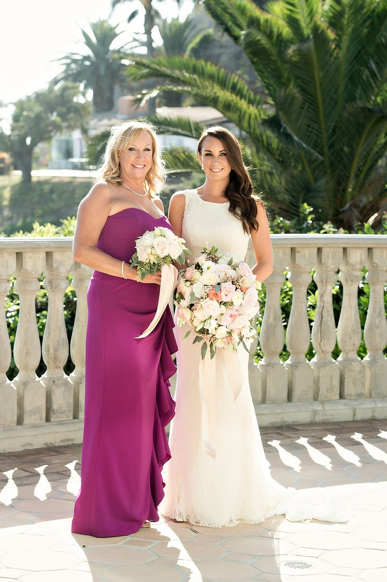bride white sheath dress mother fuchsia pink purple dress bouquets balcony