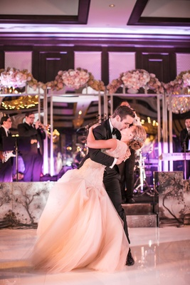 Bride and groom kiss during first dance to You Are the Best Thing by Ray LaMontagne