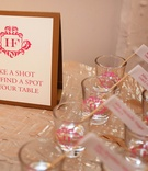 Seating card flags in shots of tequila at reception