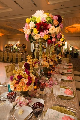 Colorful flower centerpieces on vintage wedding table