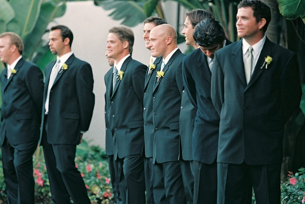 Men in black suits and boutonnieres and ties